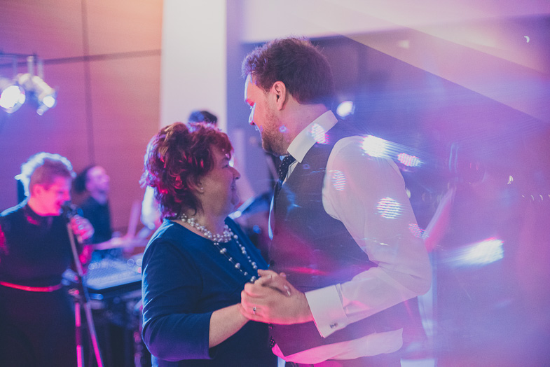 Photography of a groom dancing with his mother.