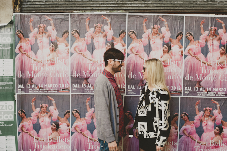 Couple in front of a ballet show poster.