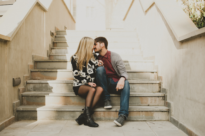 Couple on the stairs during kissing.