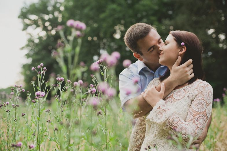 A loving couple in the middle of a flowering meadow.