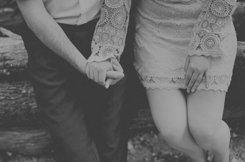 Black and white photo of the couple holding hands.
