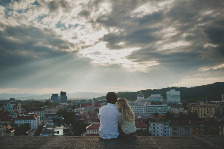 Photo of the couple on a small terrace in Ljubljana.