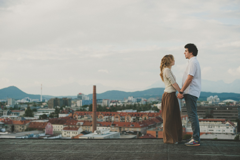 Photographing loving couple in the city.