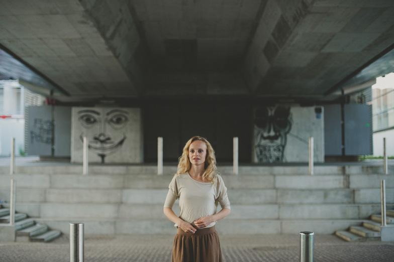 Photo of a woman on the bridge.