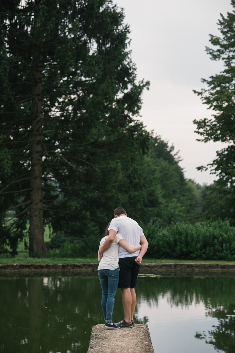 Photograph of a couple near the lake.