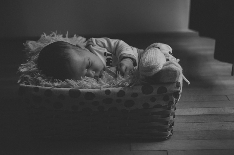 Newborn baby during sleep in a basket.